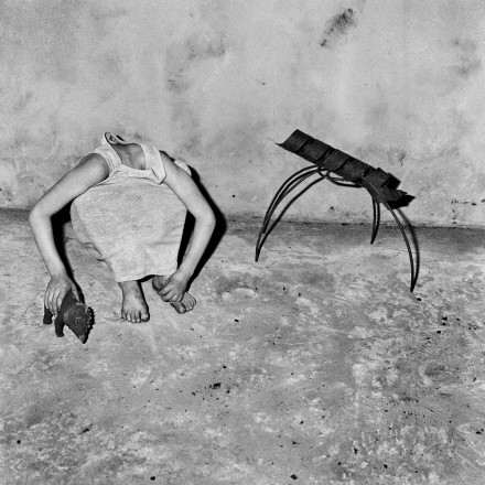 Photo by Roger Ballen: Head inside shirt